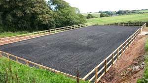 Riding arena with rubber and sand surface
